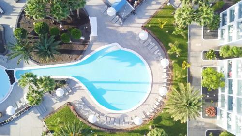 Vue sur la piscine de l'établissement Oasis Lanz Beach Mate ou sur une piscine à proximité