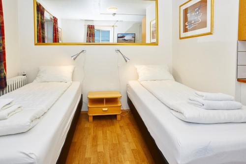 A bed or beds in a room at Reykjavik Downtown Hotel