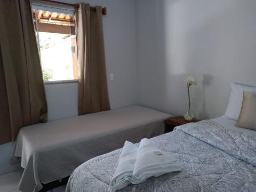 Cama ou camas em um quarto em Suites do Ratinho