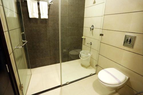 A bathroom at Best Western Swing High Katra