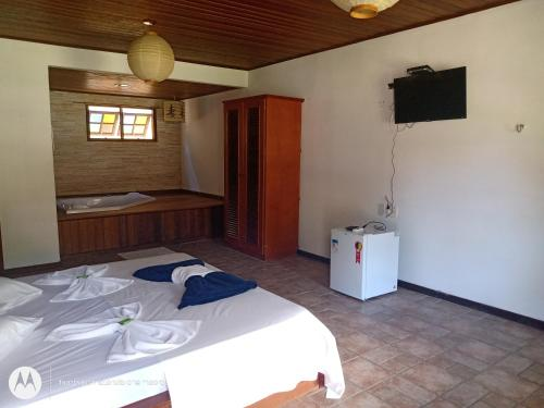 A bed or beds in a room at Pousada Nova Conquista