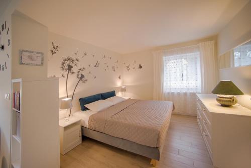 Łóżko lub łóżka w pokoju w obiekcie Apartamenty Sjesta River