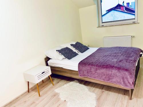 Łóżko lub łóżka w pokoju w obiekcie Apartament 48m w centrum Grójca