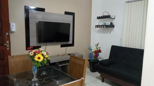 A television and/or entertainment center at Apart Mares do Sul Ilhéus