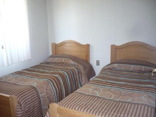 A bed or beds in a room at El Parador de Caleu
