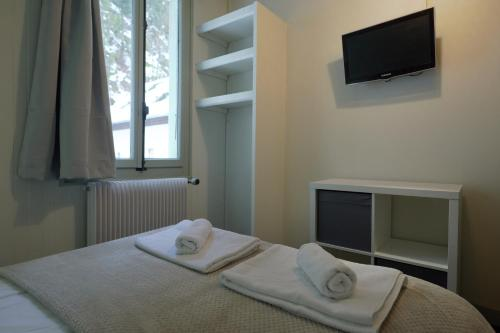 A television and/or entertainment center at Vert Lodge Chamonix