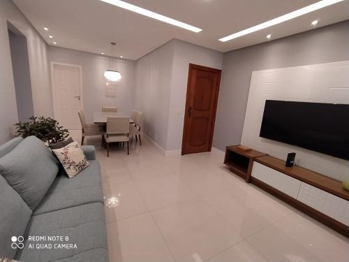 A seating area at Lindo Apartamento no Campo Grande