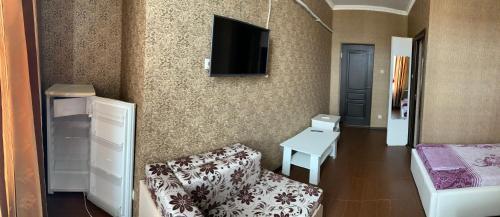 Телевизор и/или развлекательный центр в Мини-отель Алгор