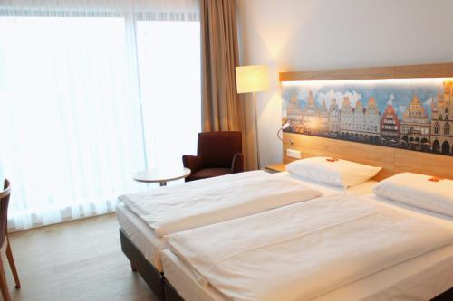 A bed or beds in a room at DRK-Tagungshotel-Dunant