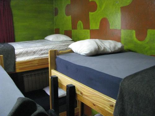A bed or beds in a room at Torre al Sur