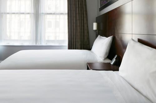 Säng eller sängar i ett rum på Club Quarters Hotel in San Francisco