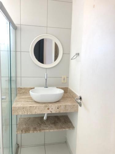 A bathroom at APARTAMENTO PRAIA DOS MILIONARIOS