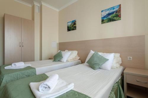 Кровать или кровати в номере Apartament on Staroobryadcheskaya