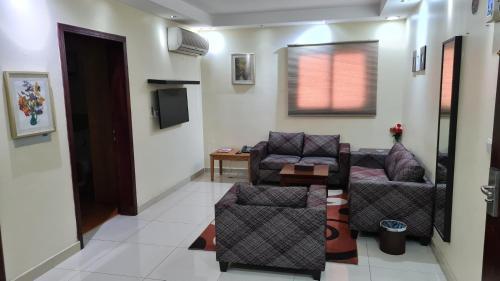 Uma área de estar em روابي الخليج للوحدات السكنية-صيوان سابقًا
