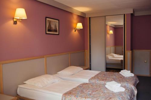 Кровать или кровати в номере Дом Рыболова