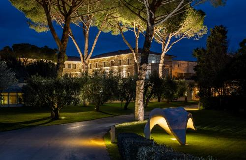 A garden outside Terme di Saturnia Natural Spa & Golf Resort - The Leading Hotels of the World