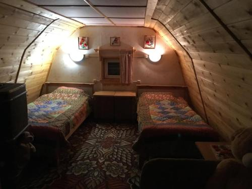 A bed or beds in a room at Гнездо аиста