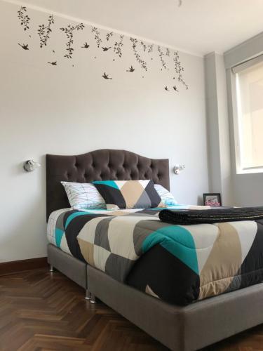 A bed or beds in a room at ESPECTACULAR FLAT DE ESTRENO totalmente equipado