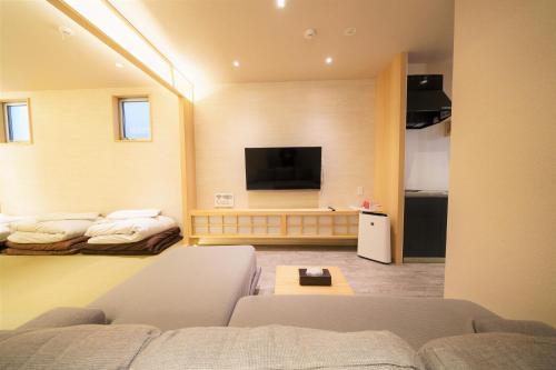 Samurais Villa Nishiooiにあるテレビまたはエンターテインメントセンター