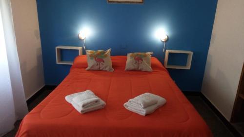 Una cama o camas en una habitación de Hotel El Pescador Lobos