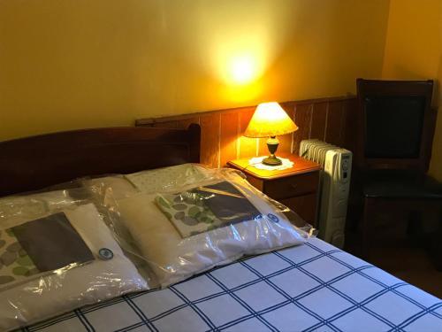 Cama o camas de una habitación en B&B La Nona