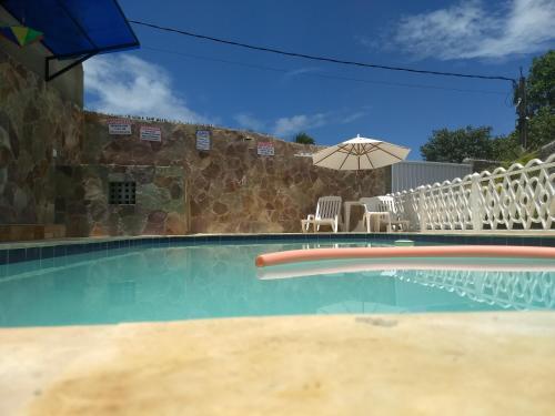 A piscina localizada em Pousada Santa Fé ou nos arredores