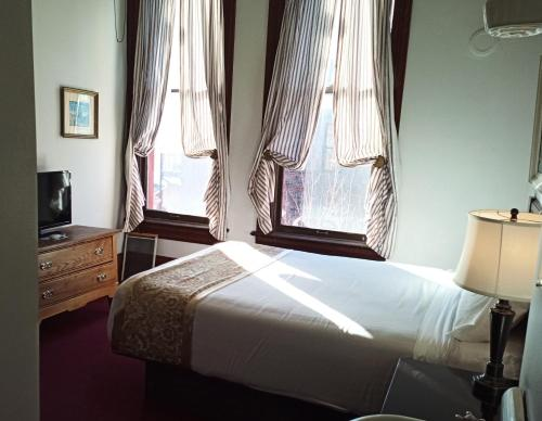 A bed or beds in a room at The Waterstreet Hotel