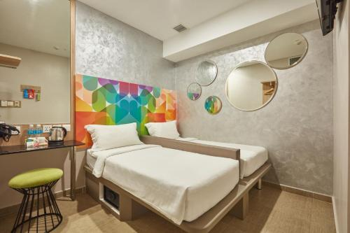 A bed or beds in a room at Ibis Budget Singapore Clarke Quay (SG Clean)
