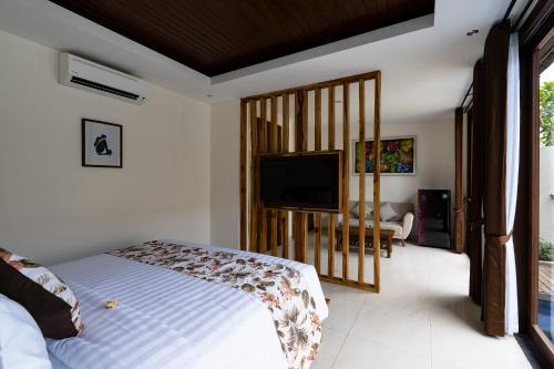 A television and/or entertainment centre at The Calna Villa Bali