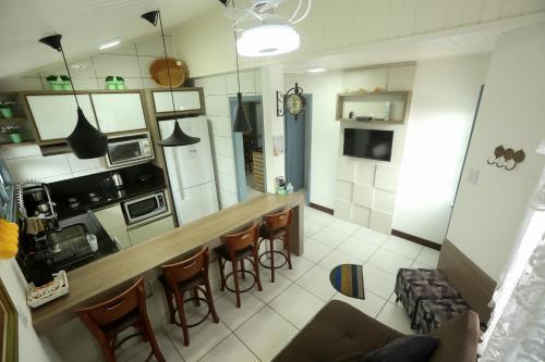 A kitchen or kitchenette at Chalé Rosé
