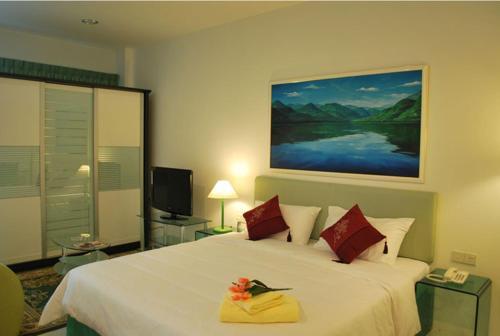 Кровать или кровати в номере MCITI Suites