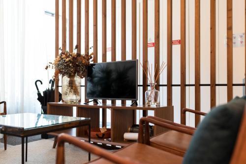 Een TV en/of entertainmentcenter bij Bloom House by Sweet Porto