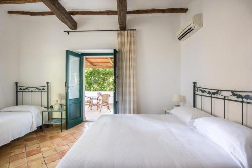 Letto o letti in una camera di Hotel Ravesi