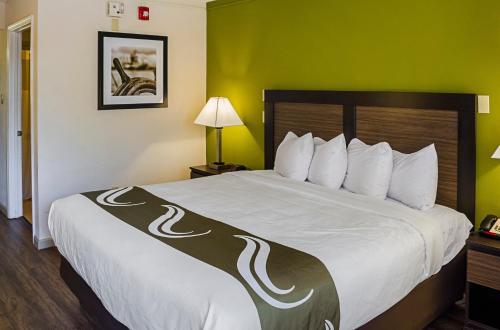 A bed or beds in a room at Quality Inn Biloxi Beach