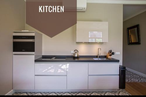 A kitchen or kitchenette at Suite 105