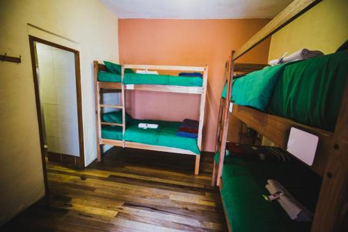 A bunk bed or bunk beds in a room at Loki Cusco