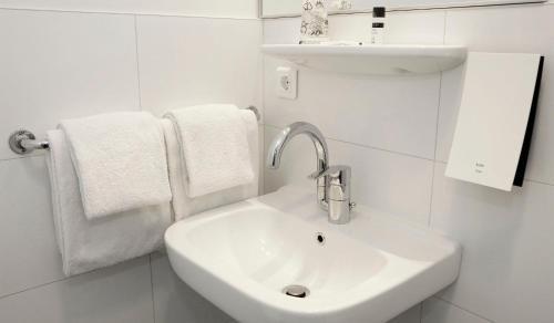 Een badkamer bij City hotel Terneuzen