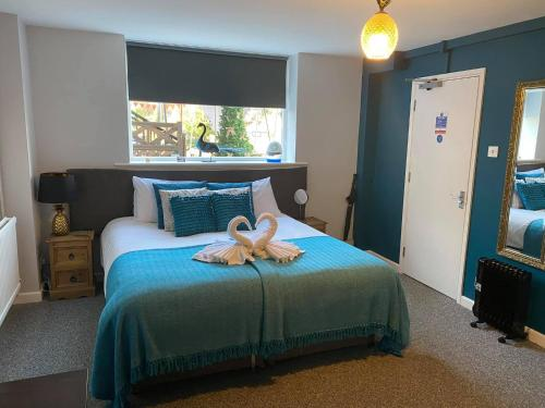 A bed or beds in a room at The Riverside inn