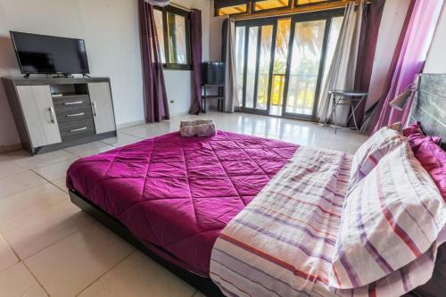 Cama o camas de una habitación en Punta Pacífico Bungalows