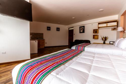 A bed or beds in a room at Life Hotel Valle Sagrado