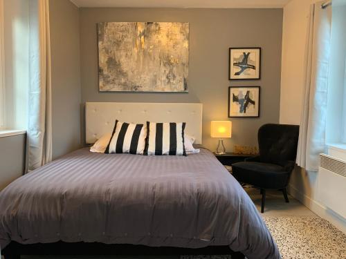 Un ou plusieurs lits dans un hébergement de l'établissement Maison Quatre Freres