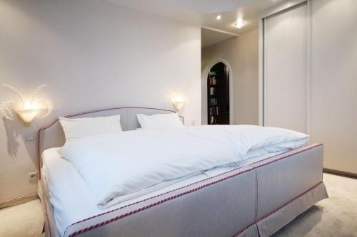 Кровать или кровати в номере Hotel Mennicken