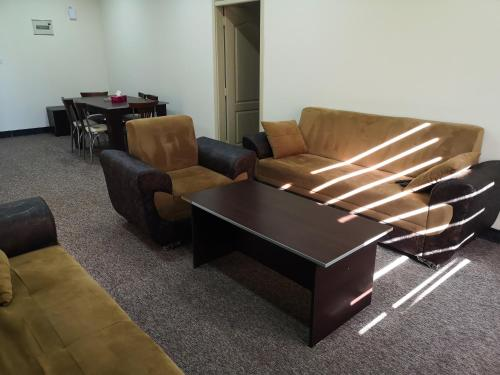 A seating area at Motel Sham