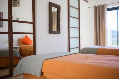 A bed or beds in a room at The West Gite at 4Vents