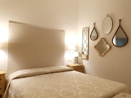 A bed or beds in a room at B&B Antico Telaio