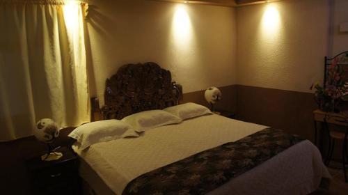 Cama o camas de una habitación en Posada y Spa Jade Teotihuacan