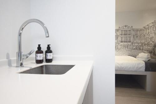 A kitchen or kitchenette at Heritage Collection on Chinatown (SG Clean)