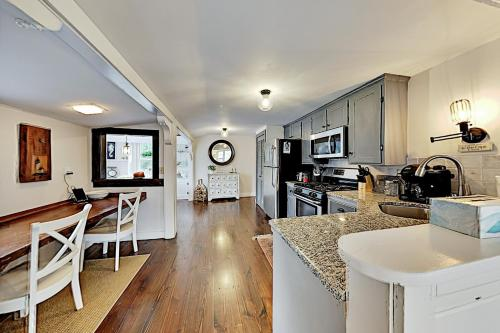 A kitchen or kitchenette at Upgraded Getaway - Firepit - Walk to Dining, Beach home