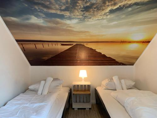 A bed or beds in a room at My Brand Boardinghouse