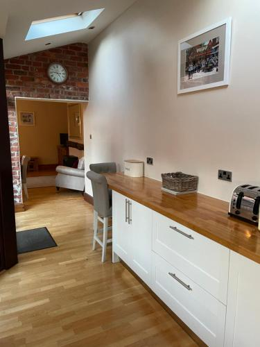 A kitchen or kitchenette at Stable Cottage Lytham